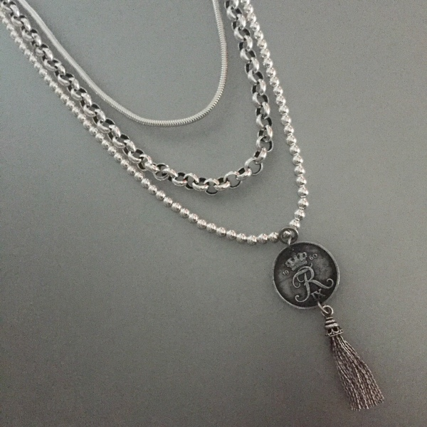 Multi Strand Silver with Tassel Coin