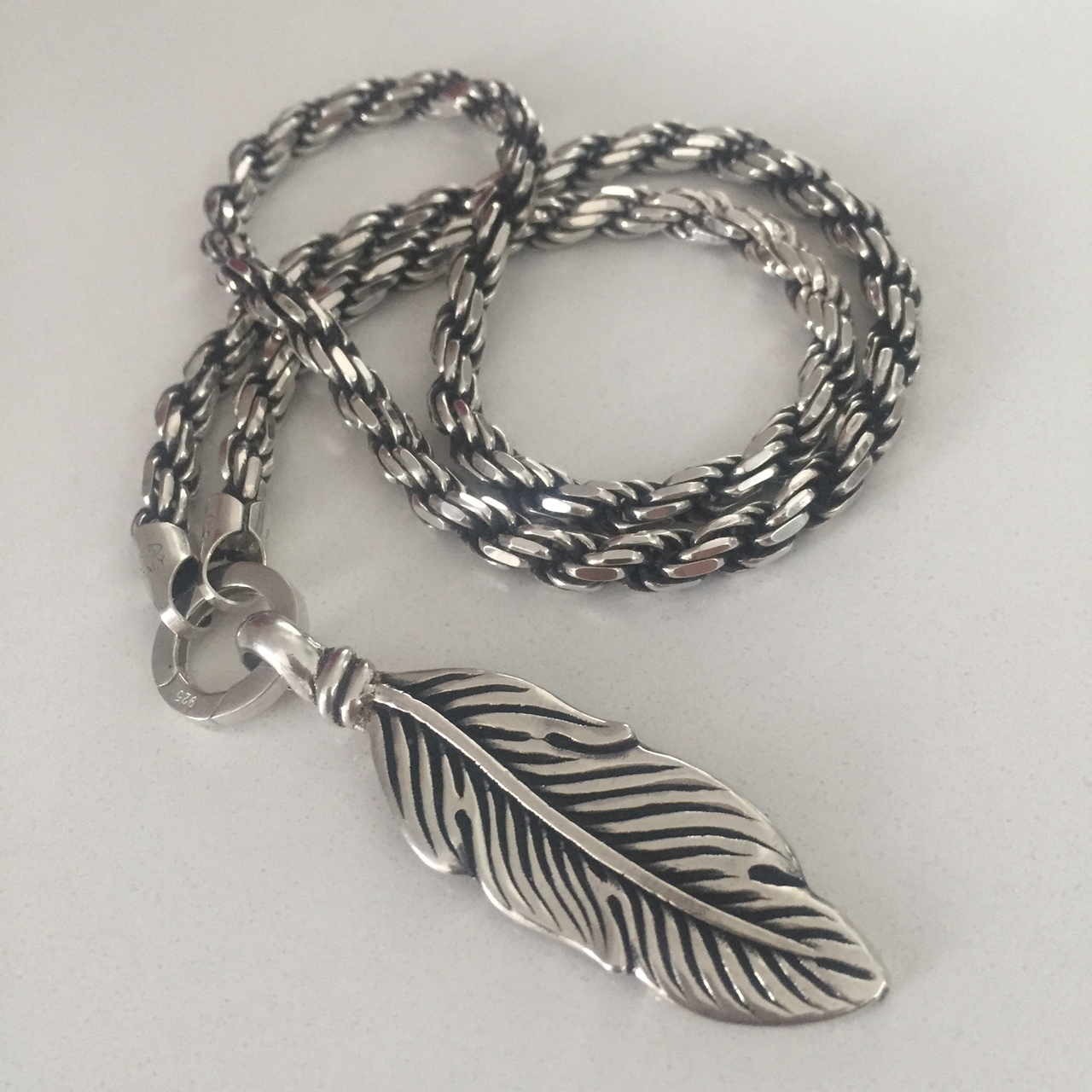 Silver Feather on Rope